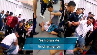 Comerciantes persiguieron, sometieron y golpearon a tres hombres, luego de que presuntamente asaltaran una joyería. Policías los aislaron para evitar el linchamiento