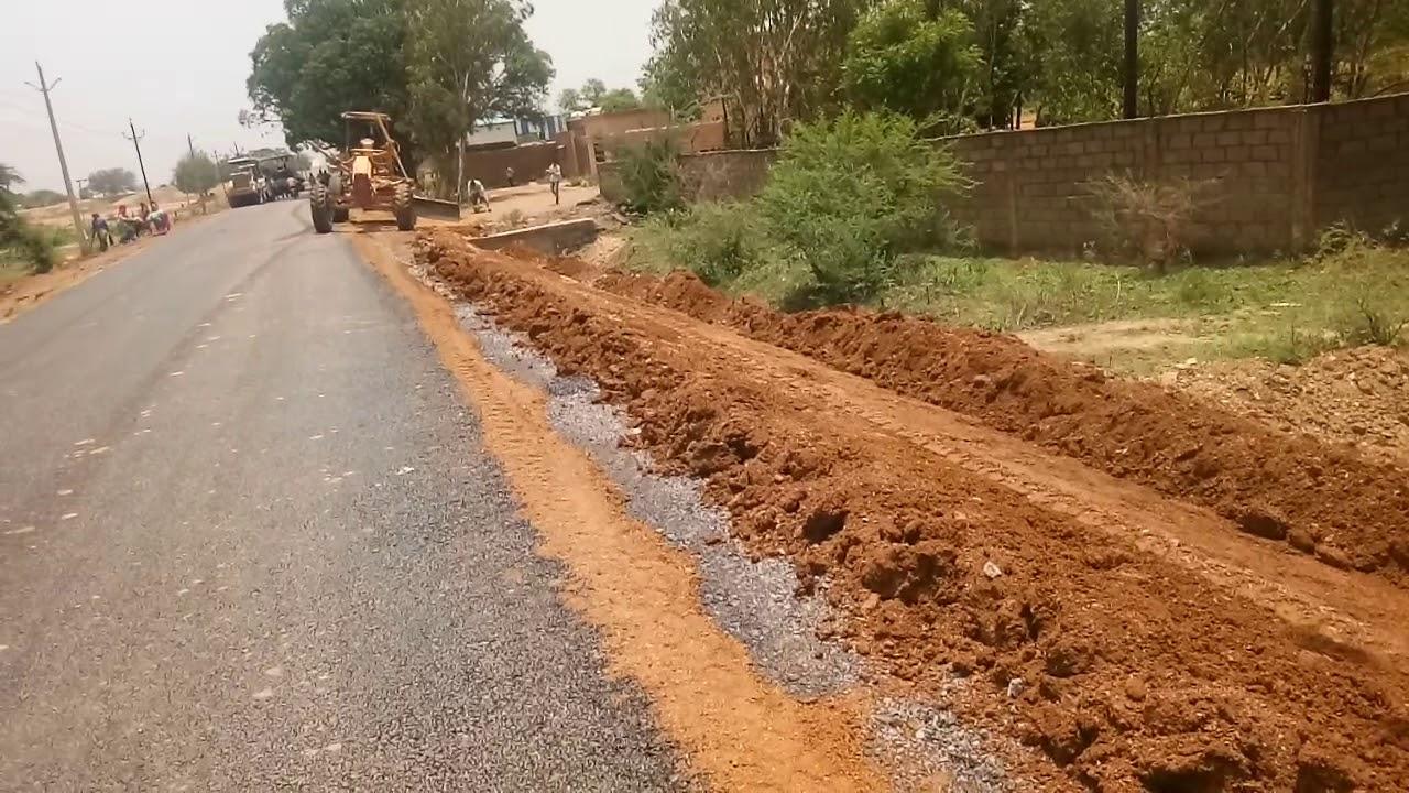 Motor Grader making road shoulder   grader machine working  road  construction civil engineering 2019