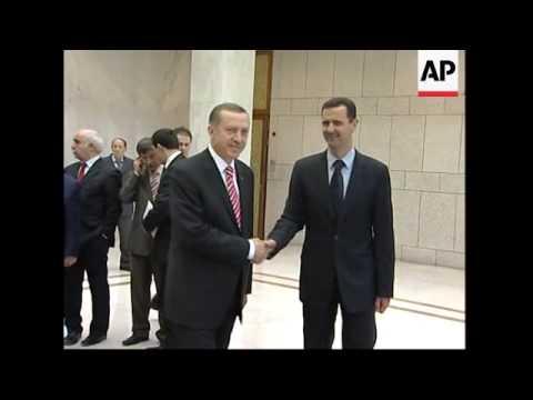 WRAP Erdogan meets FM at airport; President Assad; photo op