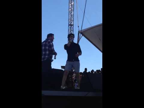 Darren Criss introducing Miley Cyrus at iHeart Radio Festival