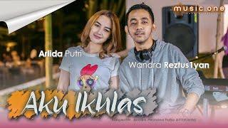 Download Arlida Putri feat Wandra - AKU IKHLAS (Official Music Video)