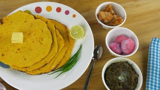 Pan shot - Punjabi Thali With freshly made Makki Ki Roti rotating on a turntable