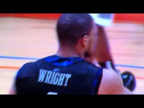 Chris Wright of Georgetown blocks Rick Jackson of Syracuse