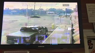 Security video shows pickup truck moments before bank crash