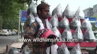 Selling helmets by the roadside in Delhi