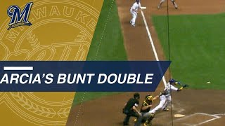 Arcia plates a pair with a crafty bunt double