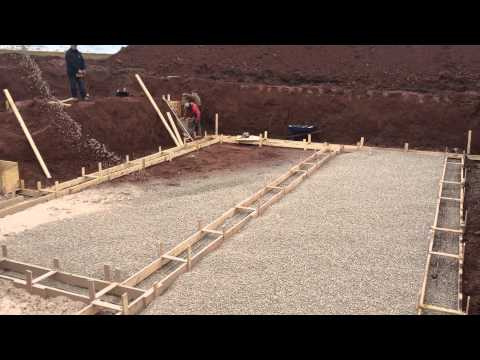Solar Home Build in East Royalty - Pouring Gravel on Day Two