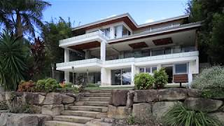 Jacaranda trees and substantial homes line exclusive Longman Terrac...