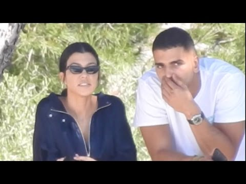 EXCLUSIVE: Kourtney Kardashian and her new beau Boxer, Younes Bendjima, enjoy the view over the cap
