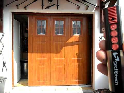 Porte de garage lat rale pg du nord youtube - Porte de garage laterale ...