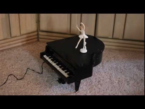Piano Music box with moving keys and dancer