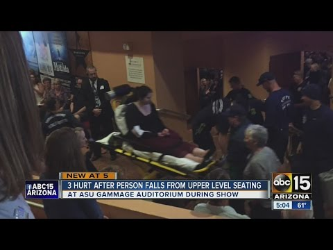 3 hurt after person falls from balcony at...