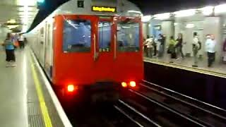 Two District Line D Stock Trains At Embankment
