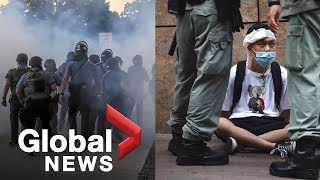 Protesters, police clash in separate protests in Hong Kong, Minneapolis