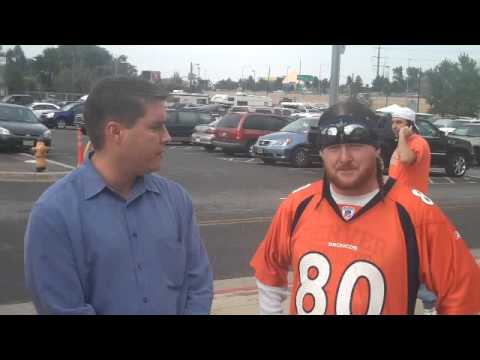 The Tribune's David Haugh chats with some Broncos fans before the third preseason game