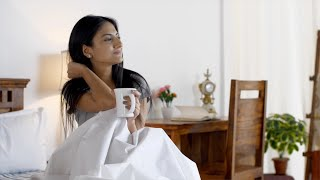 Indian teenage girl wakes up early in the morning - Relaxed morning at home during the holiday