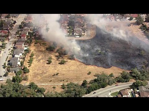 Raw Video: Grass Fire Burns Near San Jose Homes