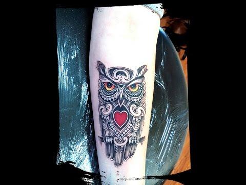 женские татуировки сова на шее