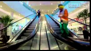 Fat woman chasing clown down the escalator.