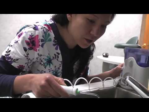 How to use a Waterpik to help Stop GUM DISEASE at home w/ Libertyville IL Dentist Dr. Sam Weisz