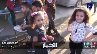 أطفال مخيم إربد يواجهون البؤس بضحكات العيد - (25-8-2018)