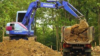 Gambar cover Mini Excavator Dump Truck Moving Spreading The Dirt Komatsu PC75UU