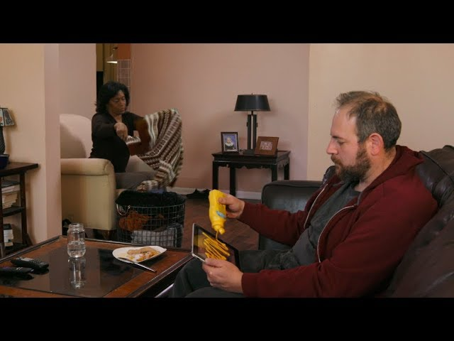 quick-thinking-guy-watching-porn-covers-ipad-in-mustard-when-his-wife-walks-in