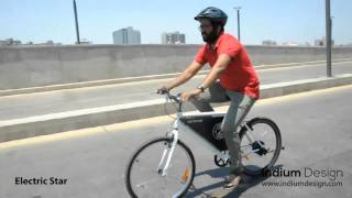 Electric star: Riding an electric bicycle on urban Indian road.