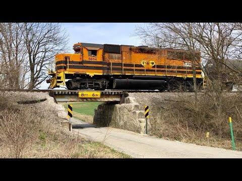 School Bus Barely Makes It Under Low Railroad Bridge!