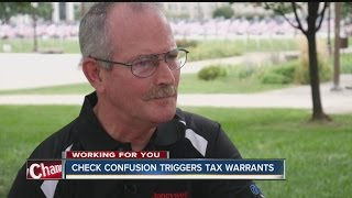 Check confusion triggers tax warrant
