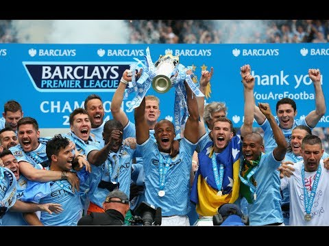Manchester City lift the Premier League trophy after being crowned champions