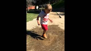 Baby dancing in mud in slow motion