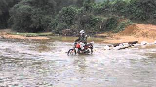 Joe Sparrow does a Vietnamese river crossing by motorcycle.