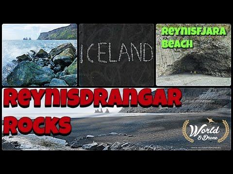 Reynisfjara beach Reynisdrangar rocks Gardar column and city Vik in Iceland - Drone Phantom video