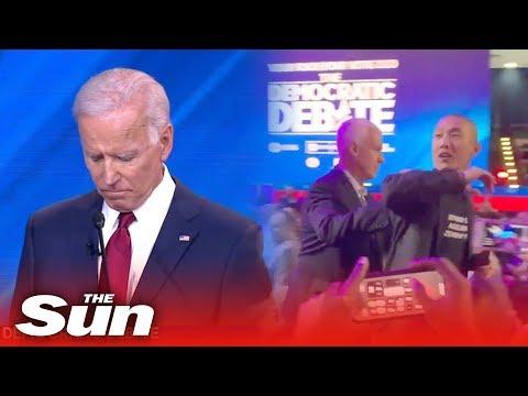 Hecklers attempt 'to storm Joe Biden on stage' during Democratic Debate