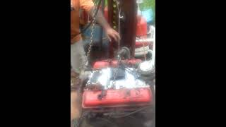 Single strand of rope pulley cord picking up a small block Chevy