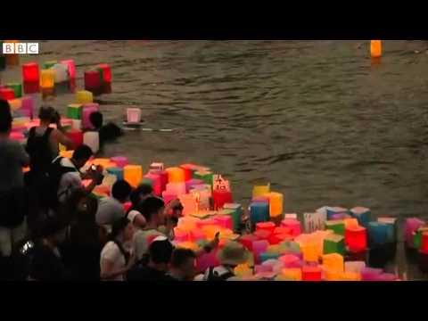 Hiroshima remembered as lanterns light up the night