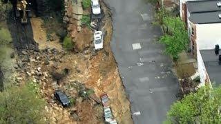 Heavy rains lash the US East Coast, cause street collapse