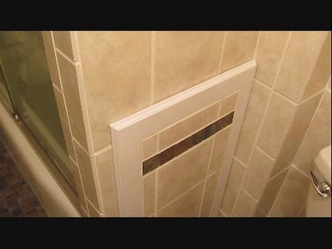 Ceramic tile access panel for bathtub plumbing - YouTube
