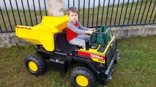 Kids ride on Tonka Dump Truck in action - 12v Power Wheels