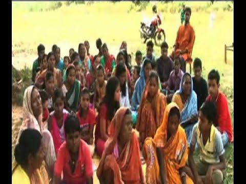 A teacher is running school at Jhargram, children are teaching adult illiterates