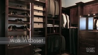 Is it a closet or a dressing room? This elegant custom closet for Him blurs the line by satisfying both functions. The closet and