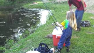 little girl catches big fish