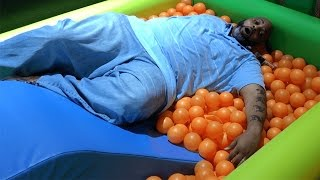 BIG MAN IN A KIDS BALLPIT WITH A FOOD REVIEW