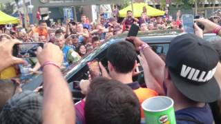 Lionel Messi arrives to a crowd of hysteric fans at Camp Nou