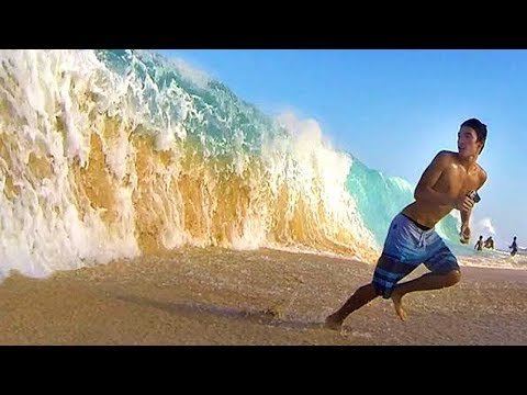 kid gets crushed by a huge wave..