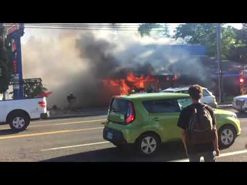 Watch: SUV crashes into building, catches fire in Gresham