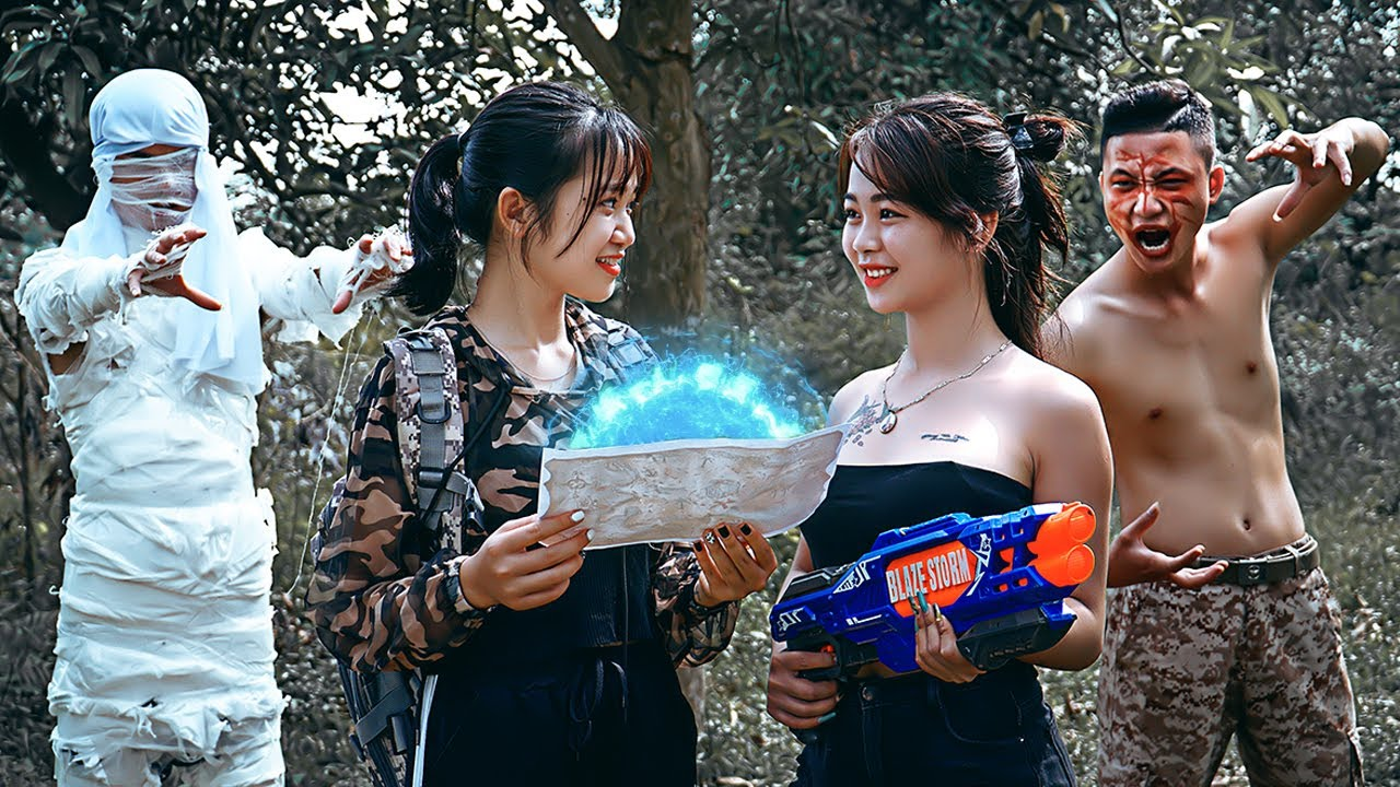 Pink Girl Nerf War: Two Girls Fight A Mummy Digger & Ms.Lily Nerf Guns Ancient Mummy Treasure