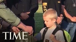 70 Police Officers Welcome Slain Officer's Son Back To School   TIME