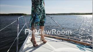 The legs of the model in high heels on the yacht